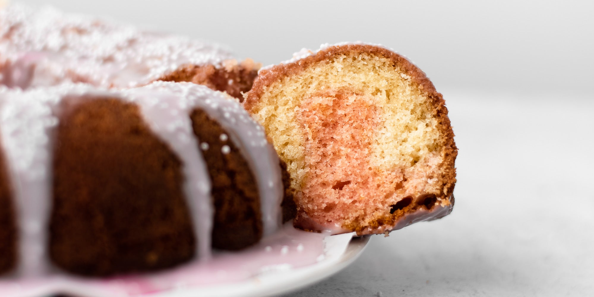 Strawberry Marble Bundt Cake with a slice taken out