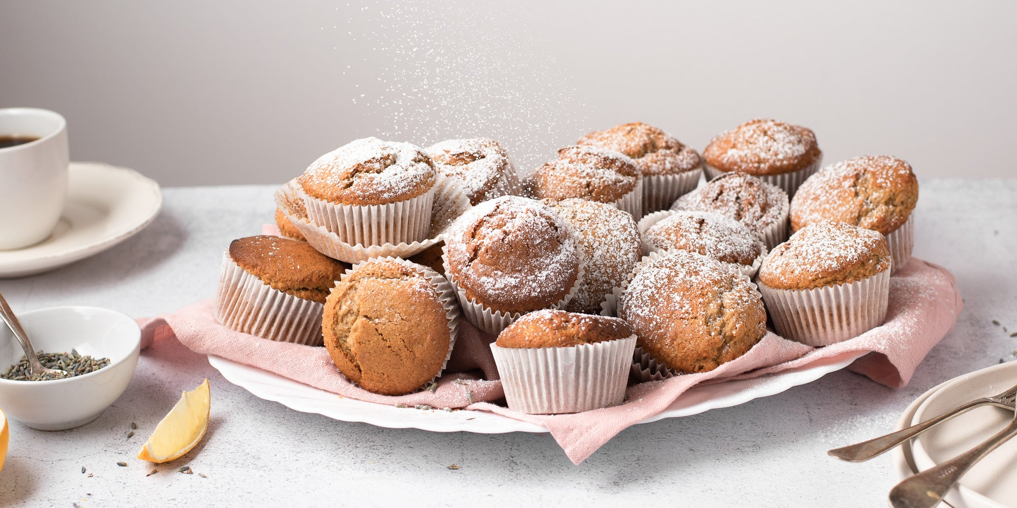 Pile of muffins coated with icing sugar