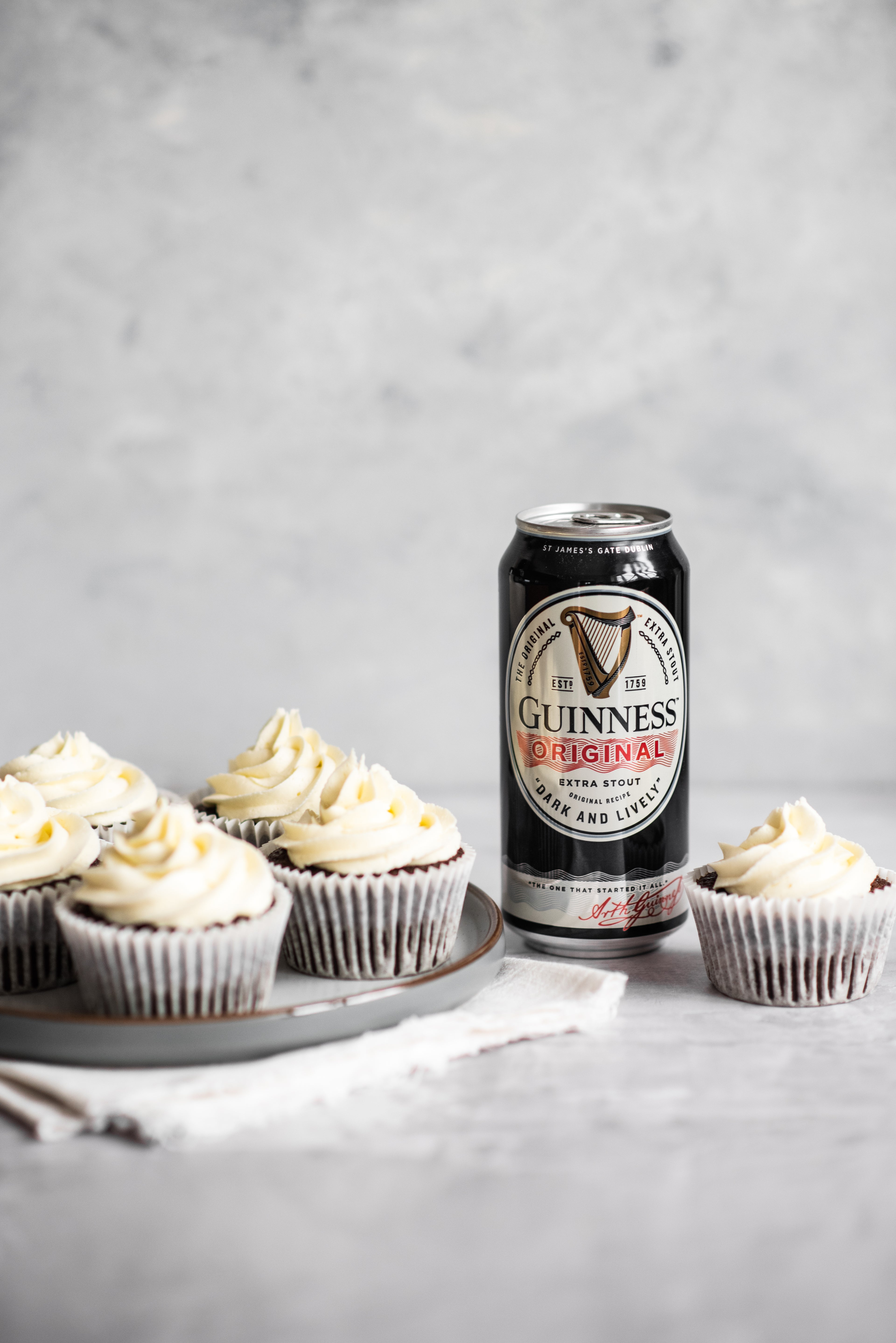 Cupcakes with a can of Guinness next to them