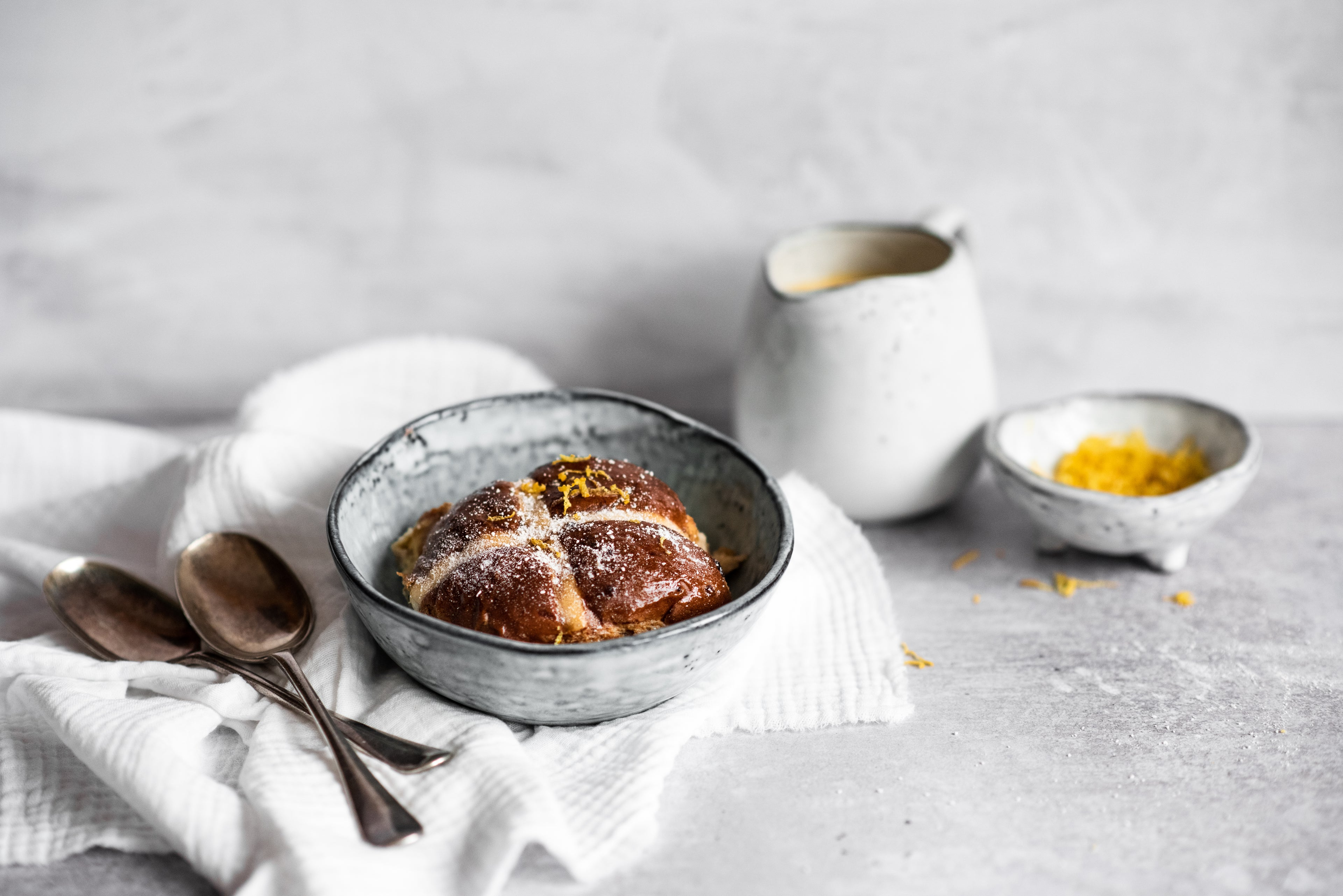 One Hot Cross Bun Bread Butter Pudding in a bowl