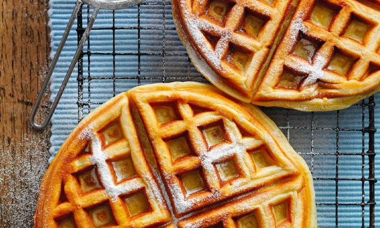 Top down view of two waffles sprinkled in sugar