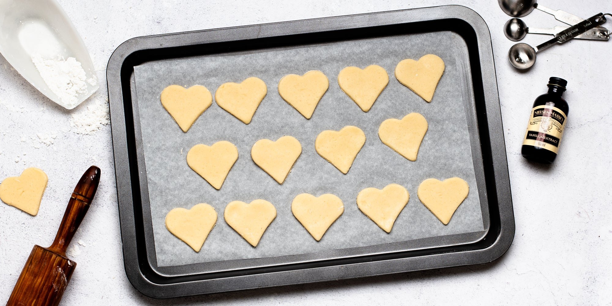 Top down view of a tray of heart shaped gluten free biscuits