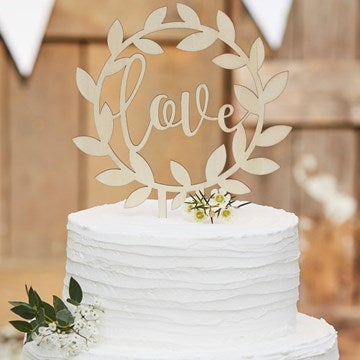Cake Topper with 'love' written on it