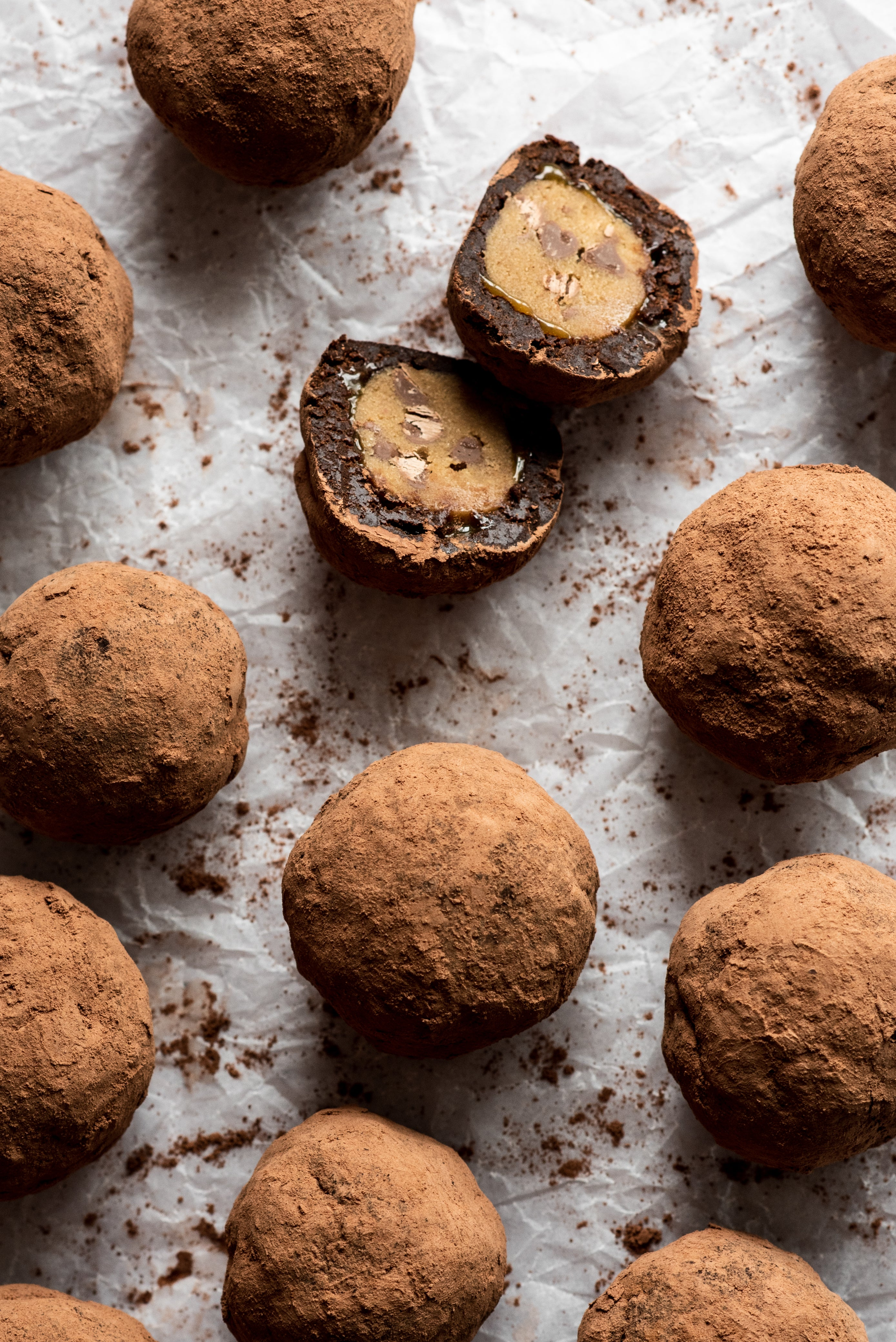 Cocoa dusted brownie truffles with one split in half