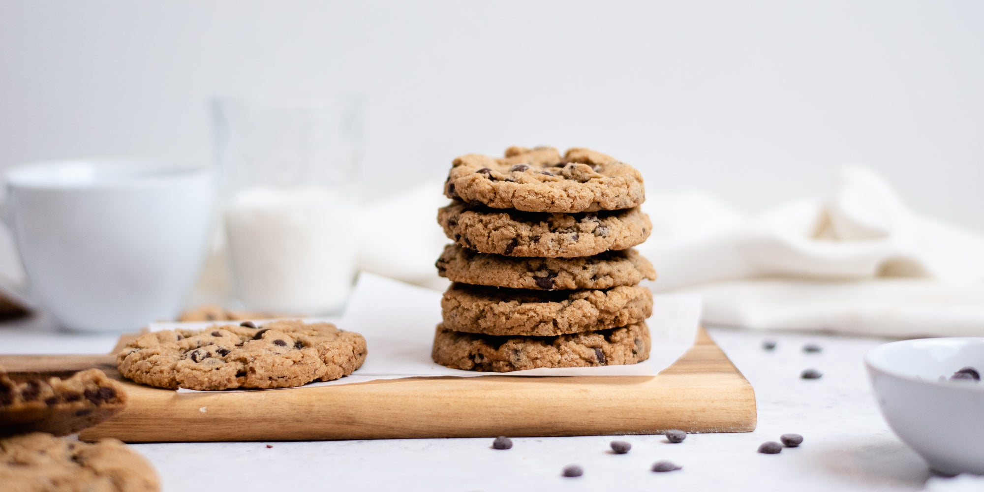 Side on view of a stack of vegan and gluten free chocolate chip cookies