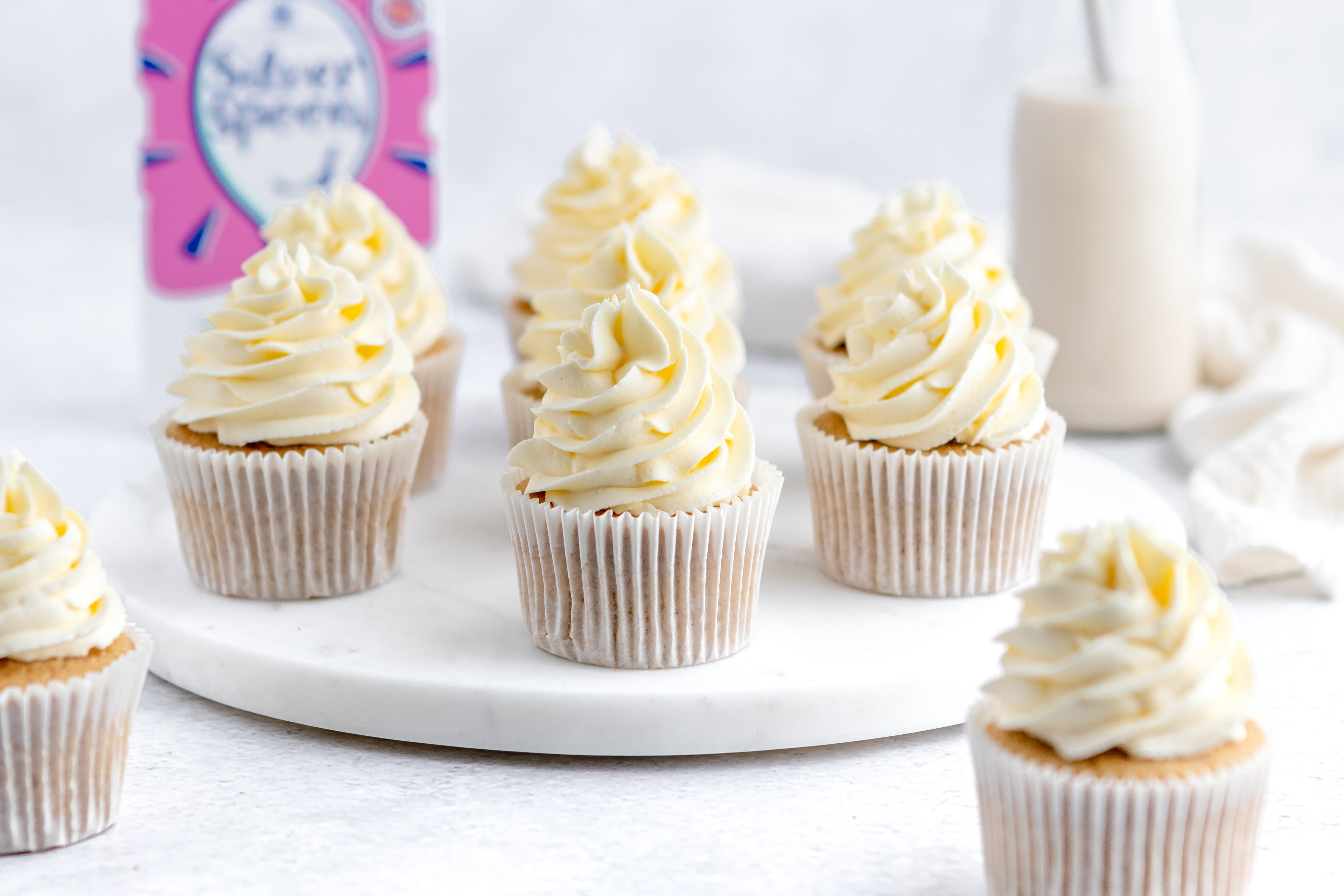 Gluten Free Cupcakes with buttercream on a serving board