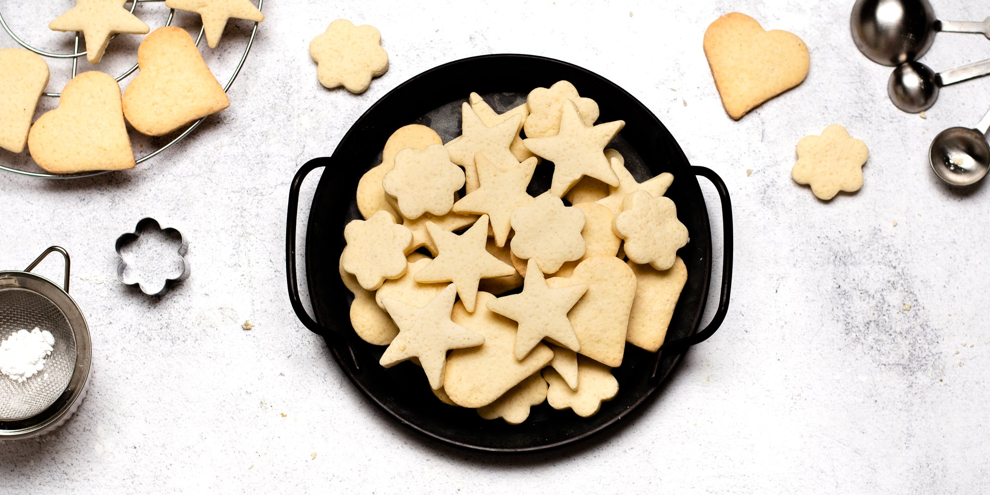 Top down view of a bowl of star shaped gluten free biscuits