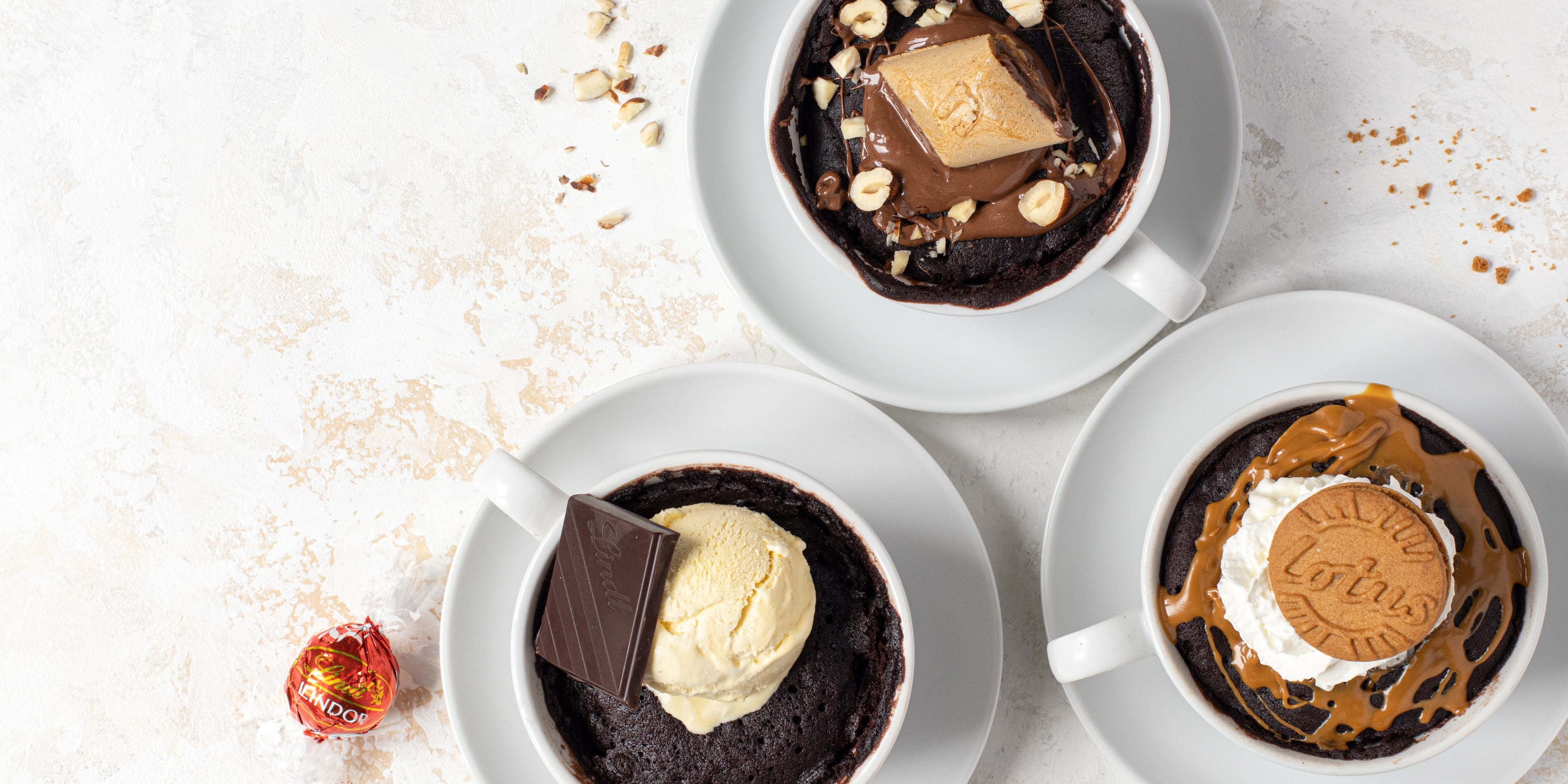 Top view of Chocolate Mug Cakes, customised with Lindt, Nutella and Lotus Biscoff