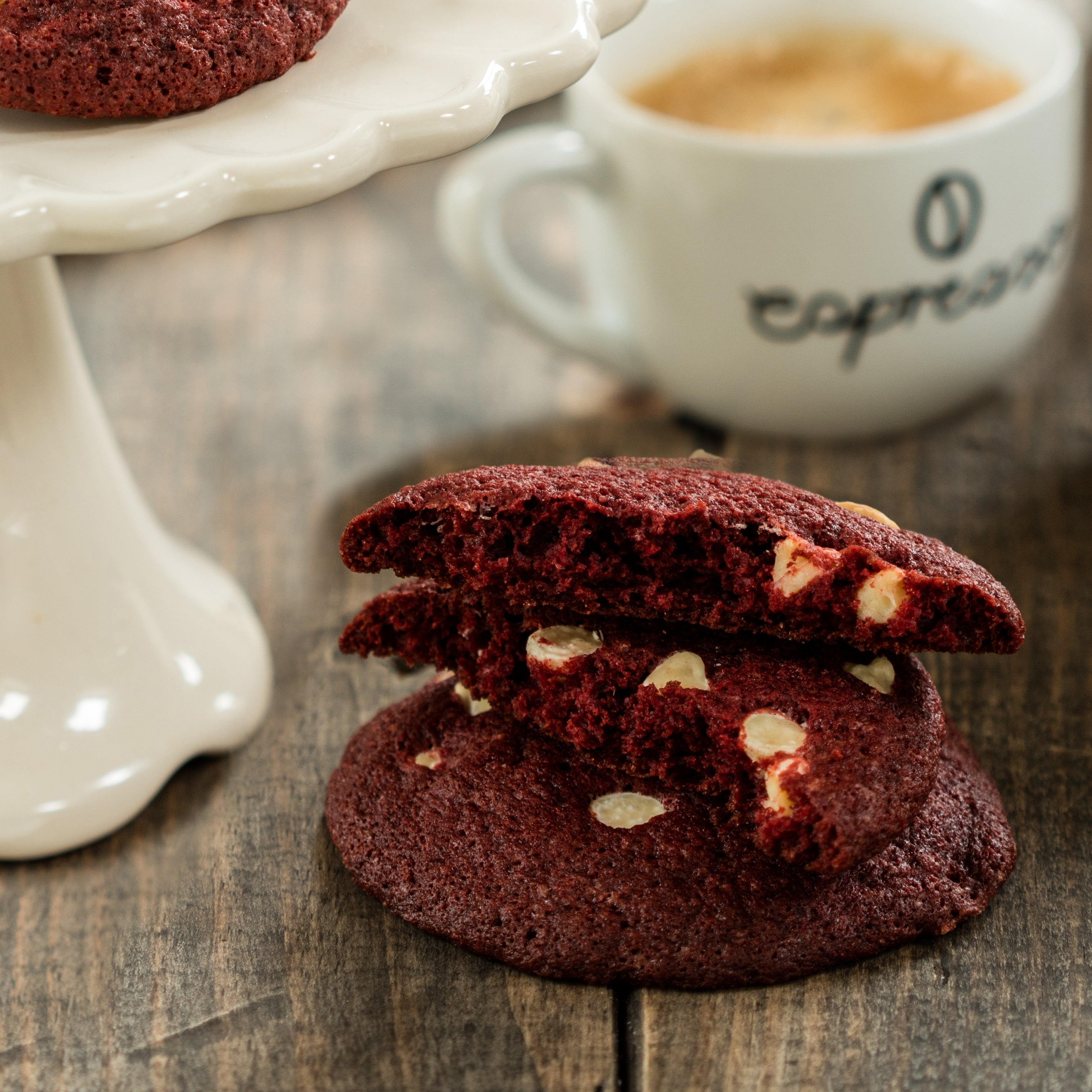 Red velvet cookie close up with cup of coffee