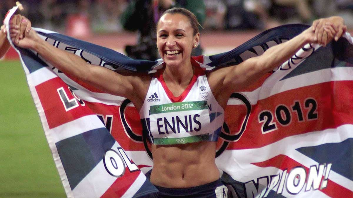 An image of Dame Jessica Ennis-Hill running with the union flag at the 2012 Olympics.