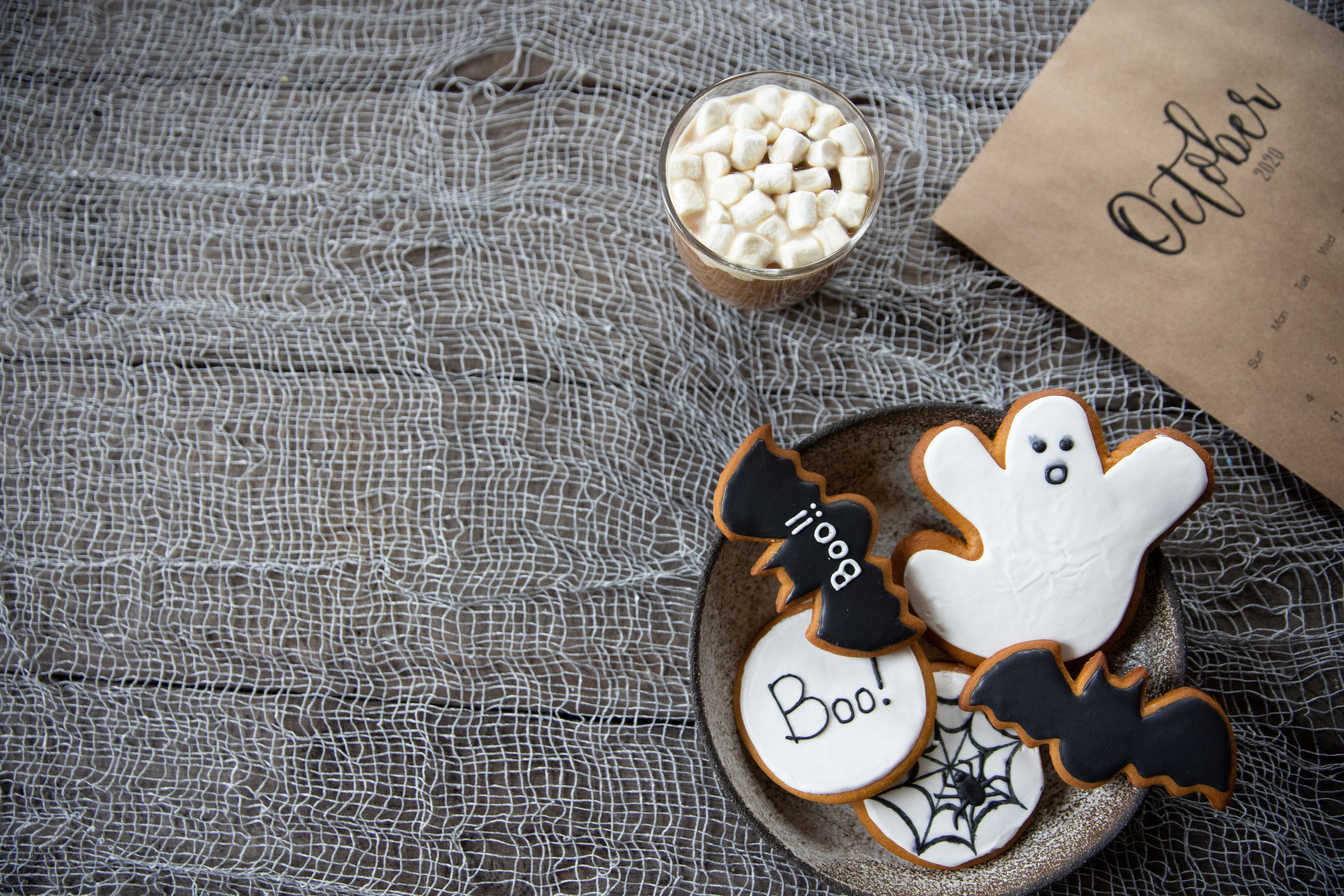 A selection of ghost biscuits in a bowl