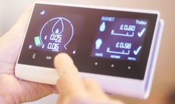 Hands holding a smart meter for business energy