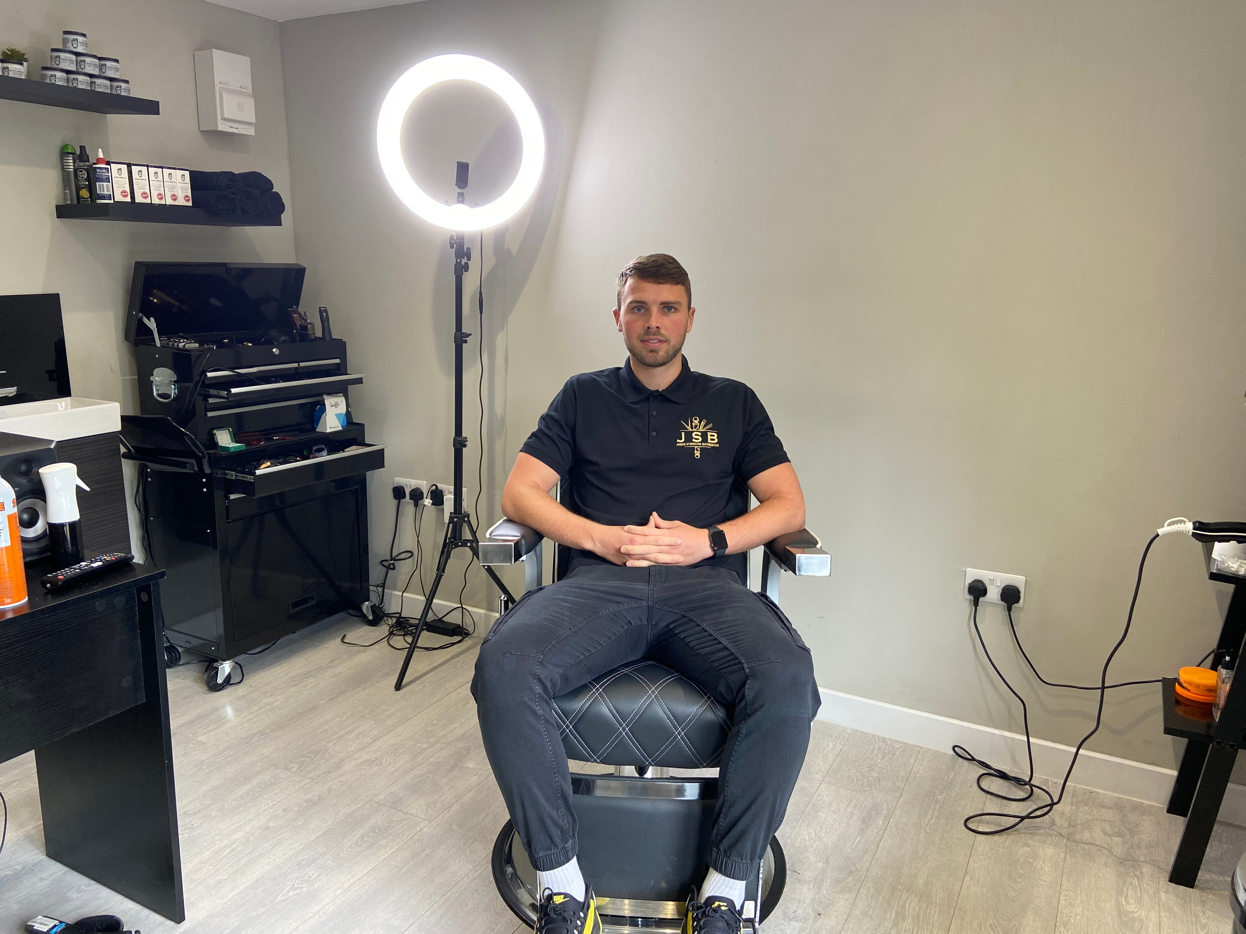Jamie sitting in his home salon