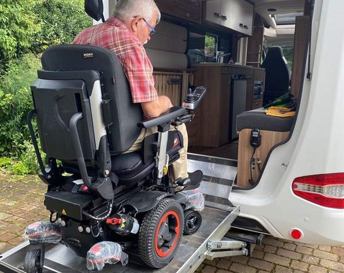 The customer testing to see if the wheelchair will fit in his motorhome
