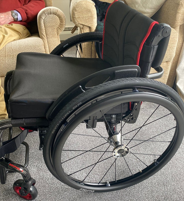 Left side view of the active wheelchair Tim is demonstrating
