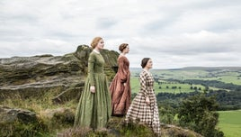 The Bronte sisters stand on the top of a hill, from BBC series To Walk Invisible