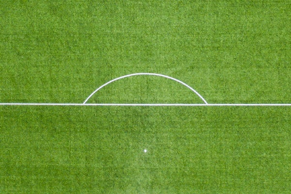 The football pitch penalty box circle looks like a rising sun