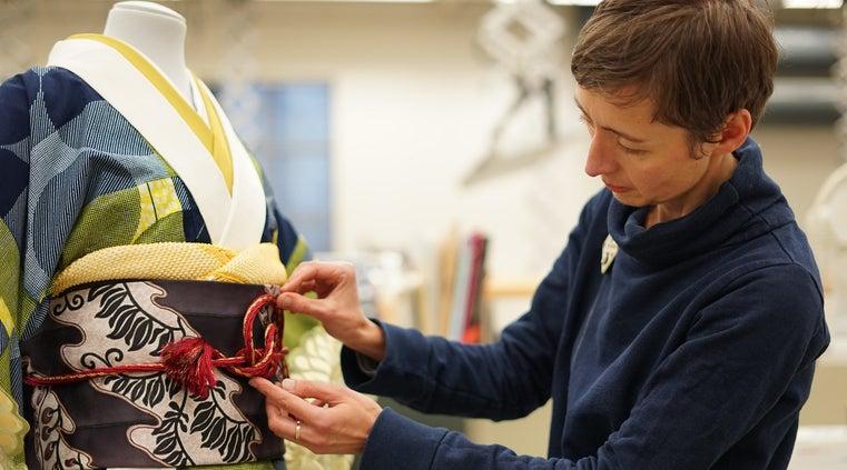 A V&A curator working on a kimono