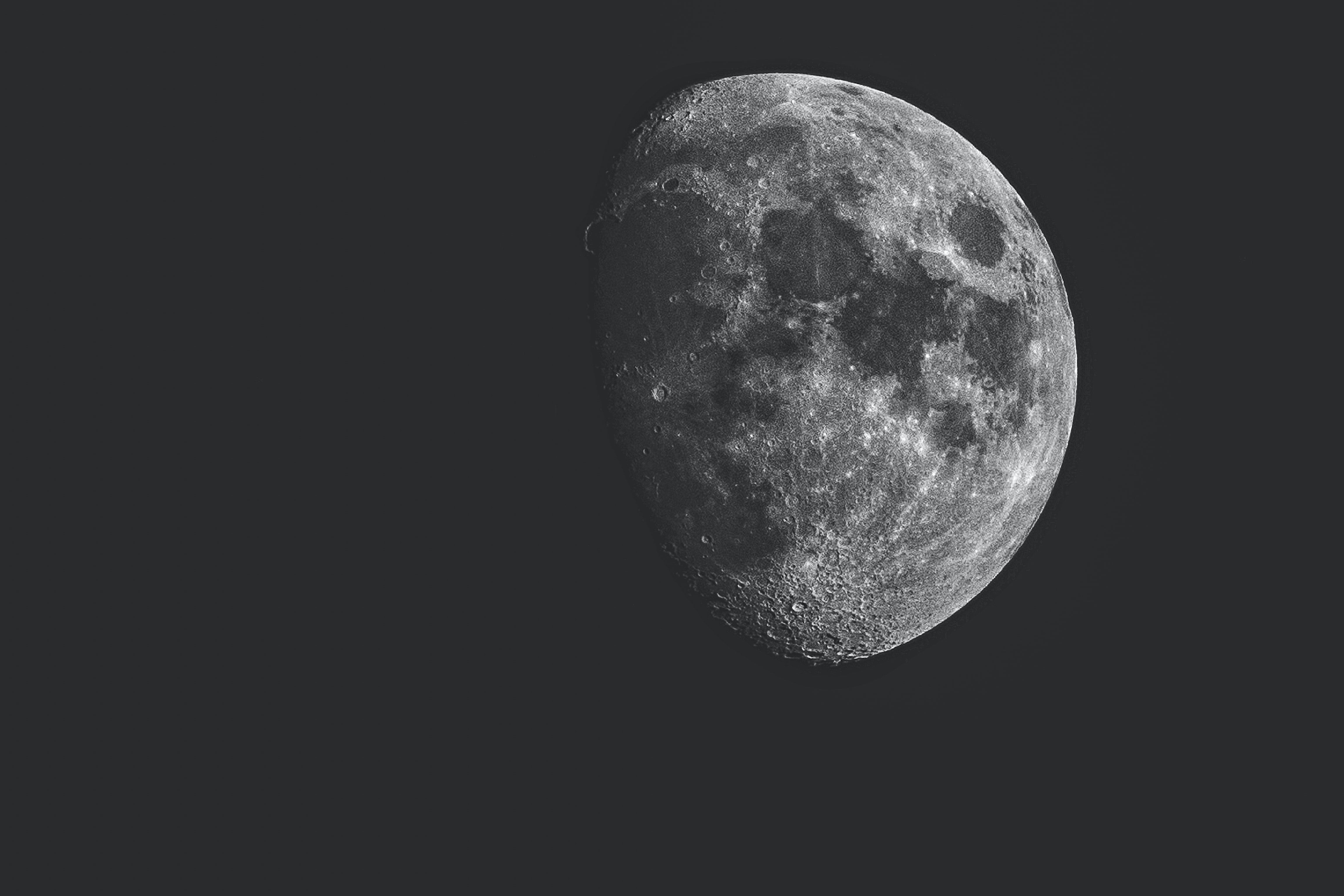 The moon, partially in shadow
