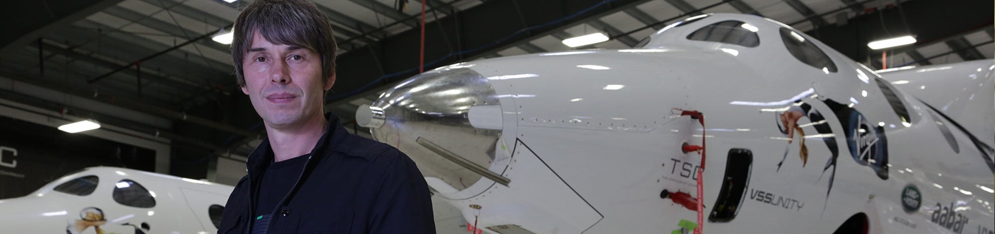 Brian Cox in front of Virgin Galactic ships