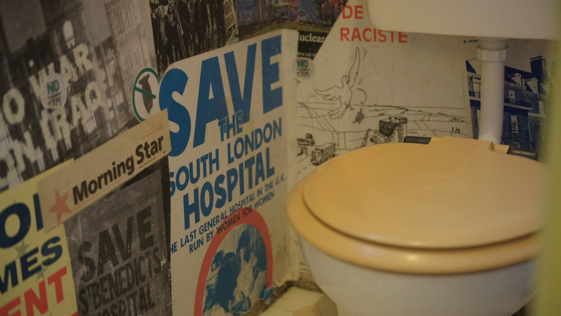 An NHS toilet covered in old NHS posters