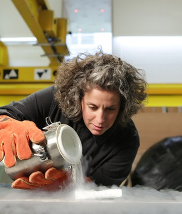 Zoe Laughlin pouring liquid Nitrogen in The Secret Story of Stuff