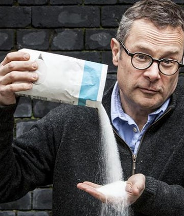 Hugh Fearnley Whittingstall pouring the contents of a bag of sugar into his own palm