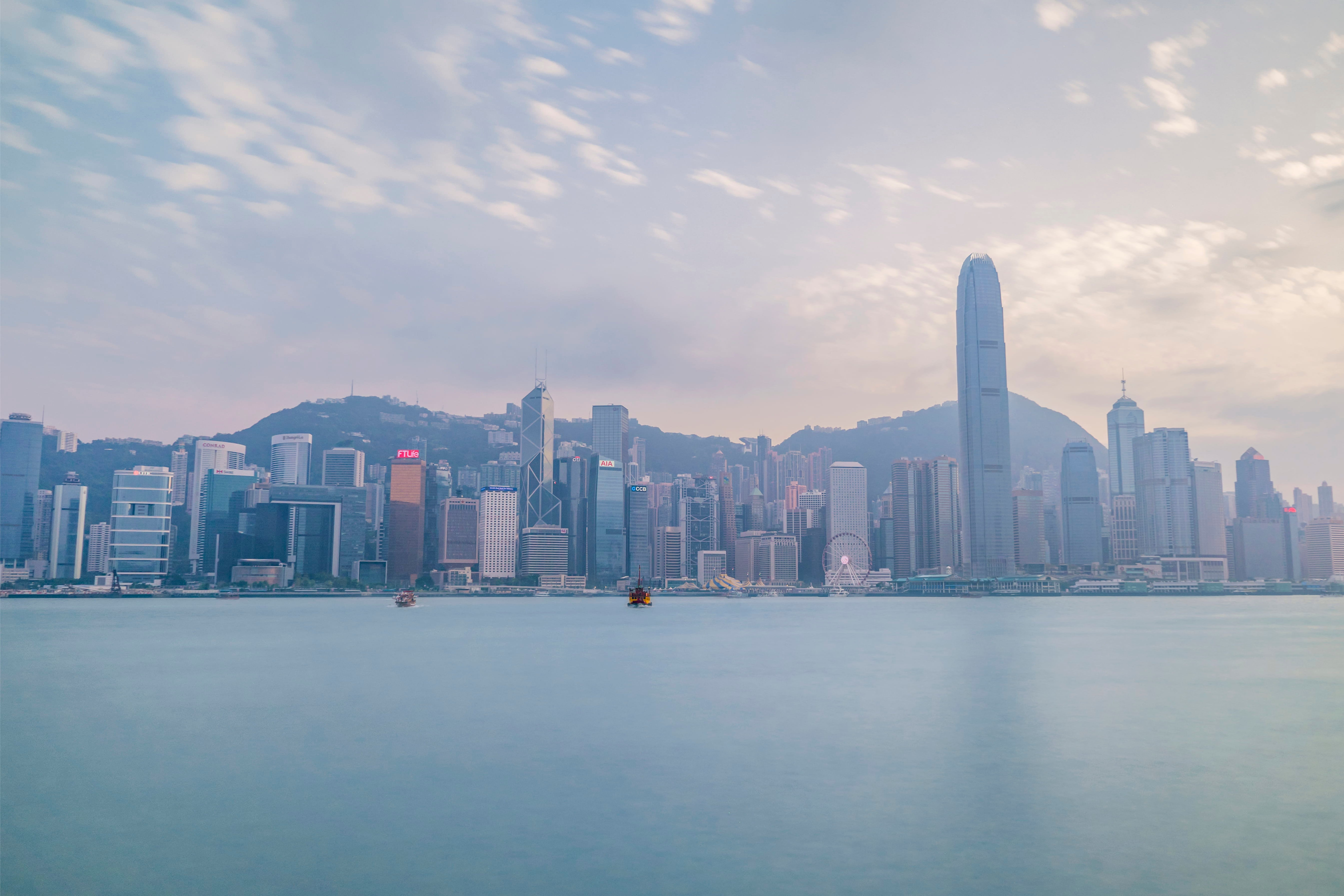 A photograph of the Hong Kong skyline, with lots of skyscrapers lined up along the water's edge.