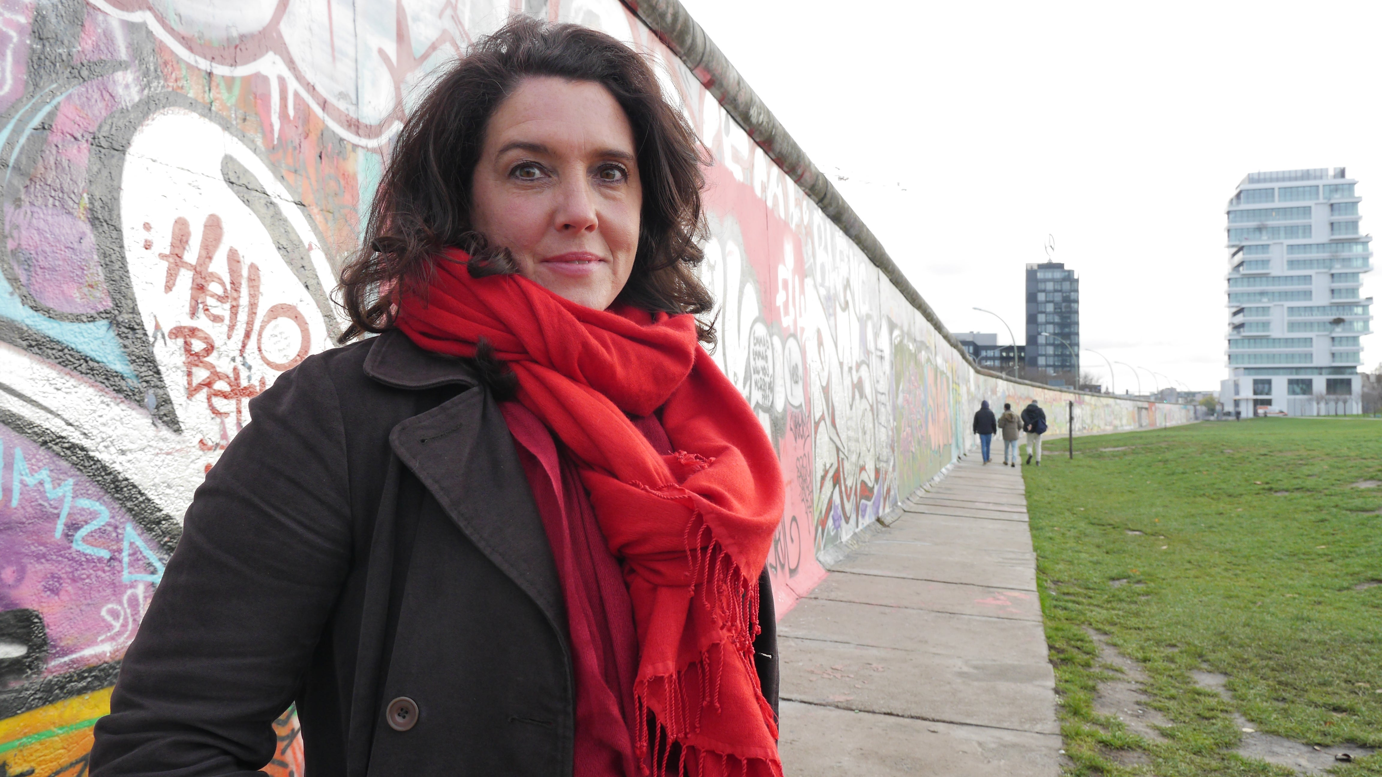 Presenter Bettany Hughes at the Berlin Wall