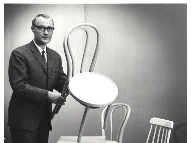 Ingvar Kamprad holding a chair