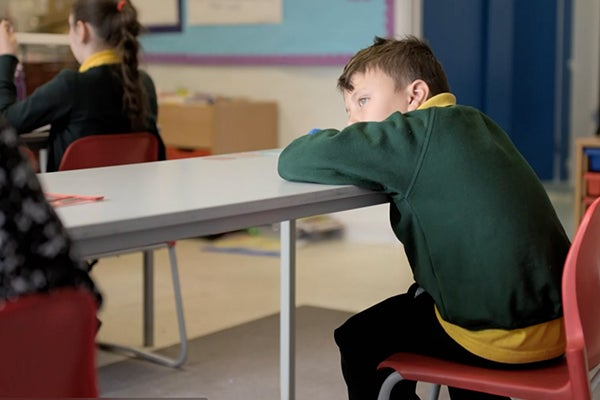 A school boy leans on his desk, from Don't Exclude Me. Copyright BBC