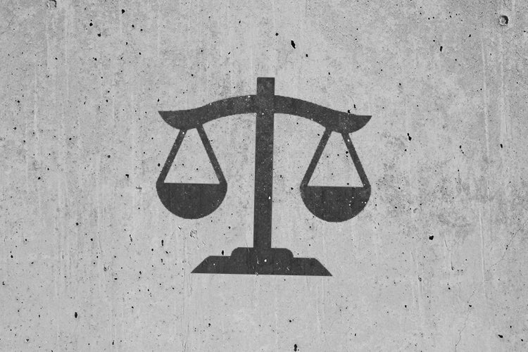 Legal scales graphic on a concrete background