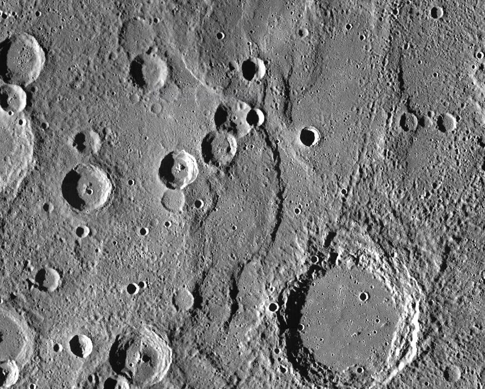 Endeavour Rupes, the shadowed escarpment in the middle of a 400km wide view of Mercury. NASA/JHUAPL/CIW