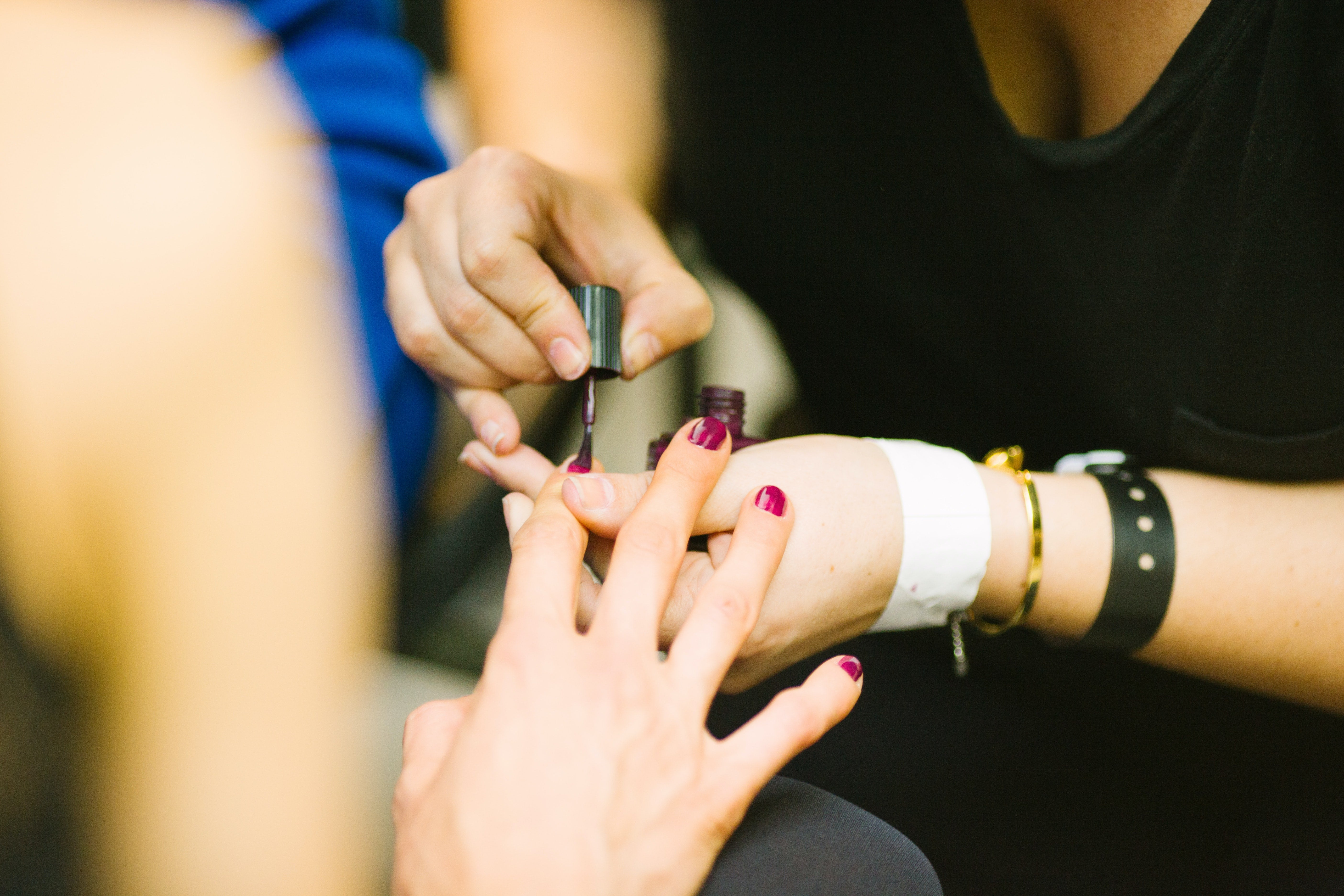 A woman gets her nails painted