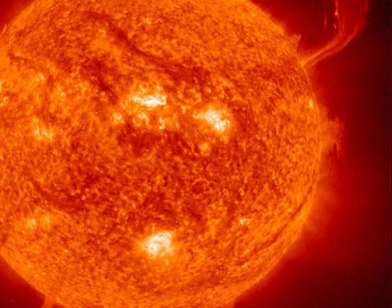 Image of the burning Sun emitting solar flares