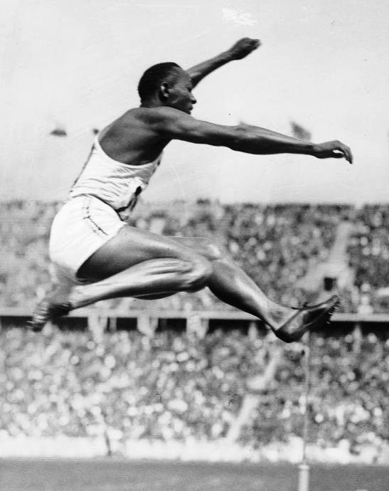 Jesse Owens jumps to victory