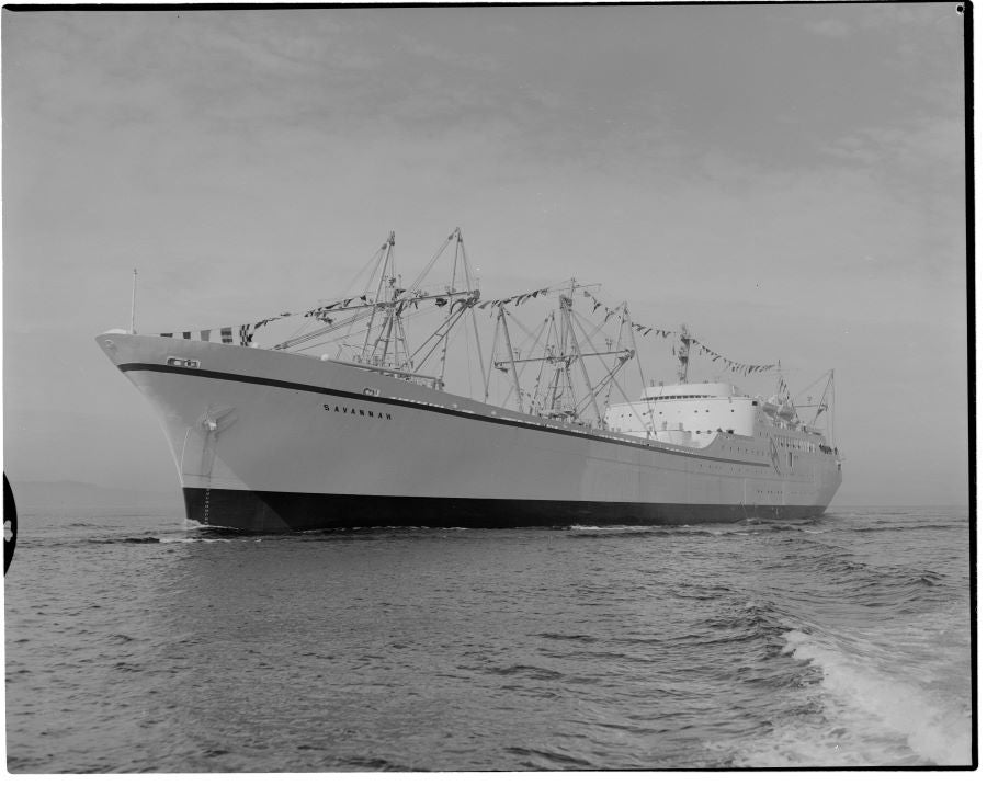 A black and white phot of a large ship on water, the NS Savannah