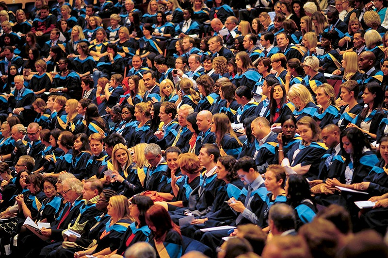 Students graduating from The Open University