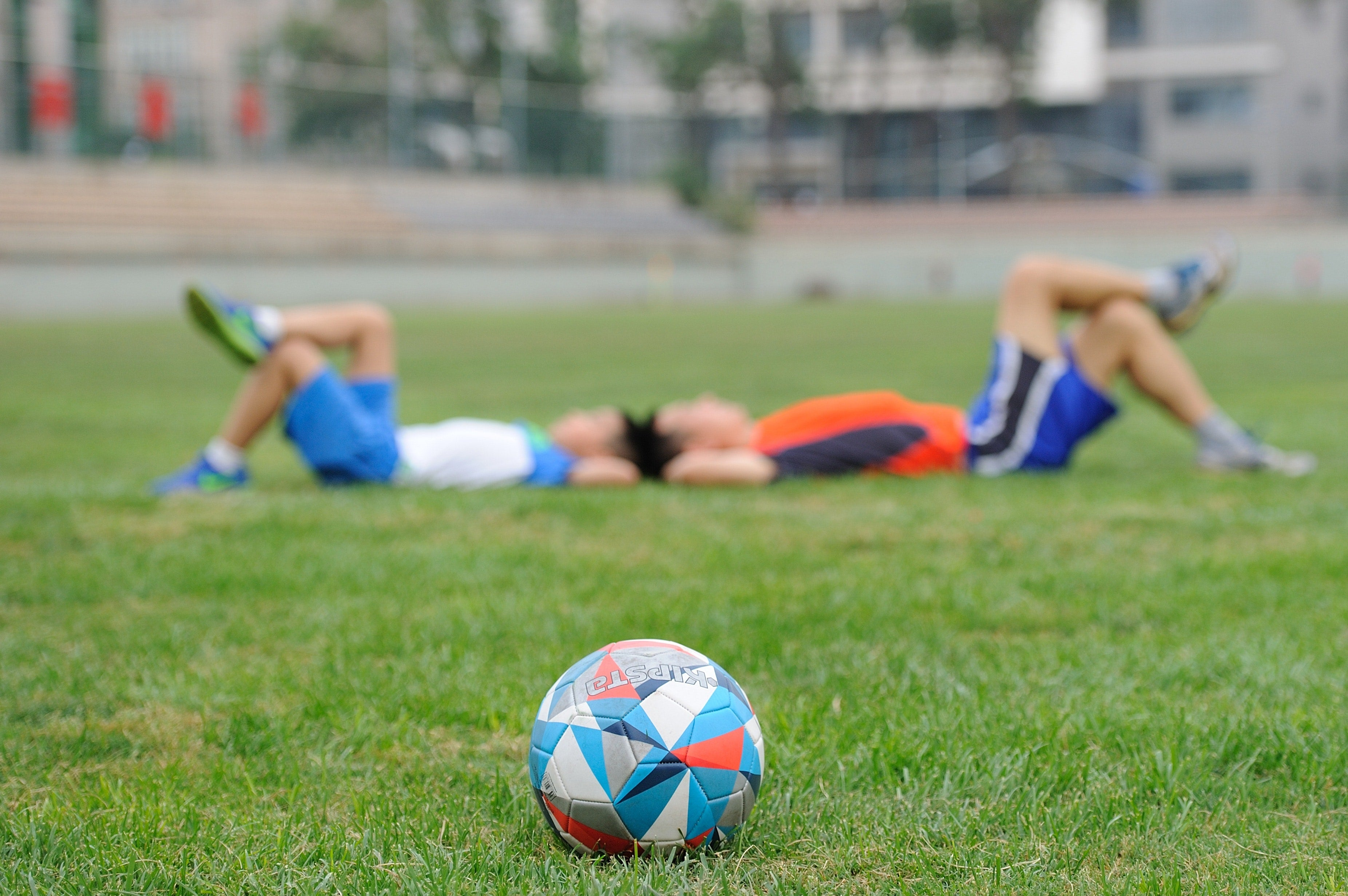 Father and son rest after playing football