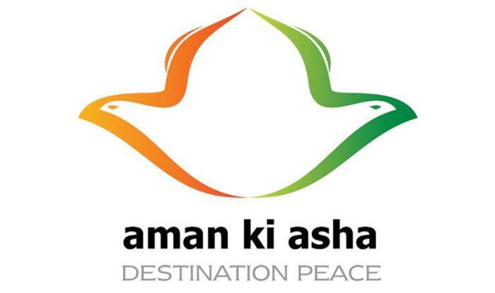 The logo for Aman Ki Asha. The abstract gold and green shape gives the impression of two birds facing away from each other.