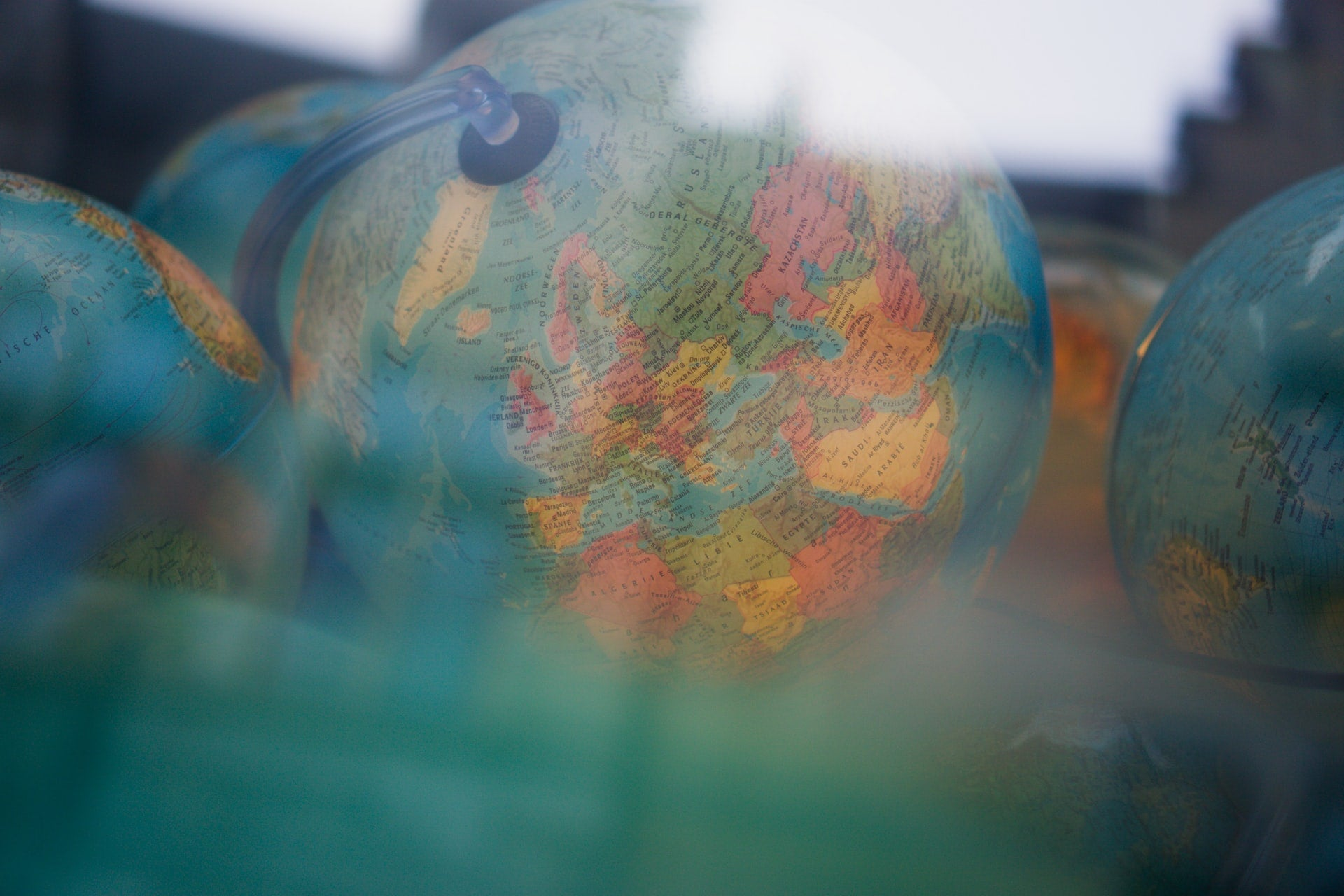 A picture of a globe, taken through some glass