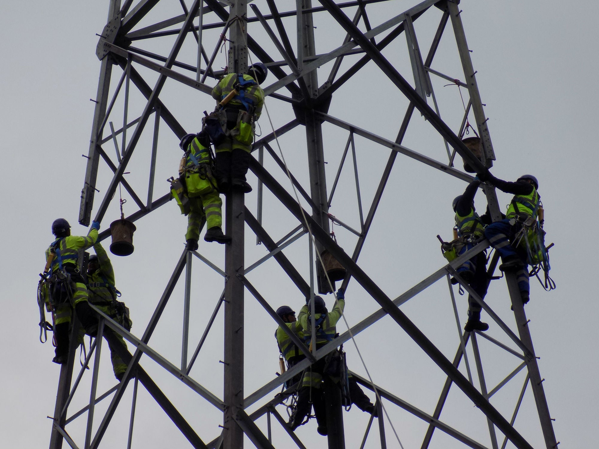 Engineers work on pylon on OU/BBC series Power to the People
