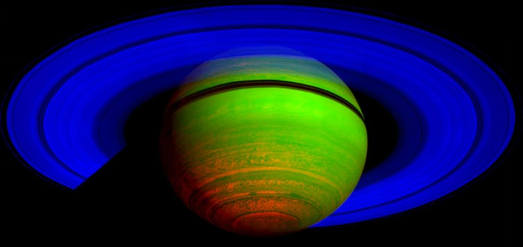 Saturn by NASA's Cassini orbiter. This is a false colour image recorded using three infrared wavelengths, and shows patterns of thermal emission rather than reflected sunlight. NASA/JPL/ASI/University of Arizona