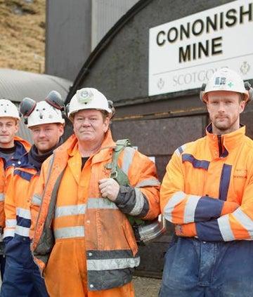 7 men stood outside of Cononish Mine