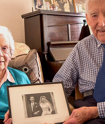 Betty and Eric Tyley pose with their wedding picture