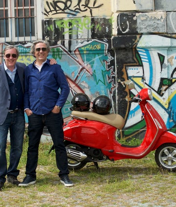 Andrew Graham-Dixon and Giorgio Locatelli stand by a Vespa scooter in Rome