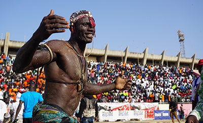 In Senegal, professional wrestlers wear ritual amulets and cast spells and dowse themselves in potions to give them the edge in the arena.
