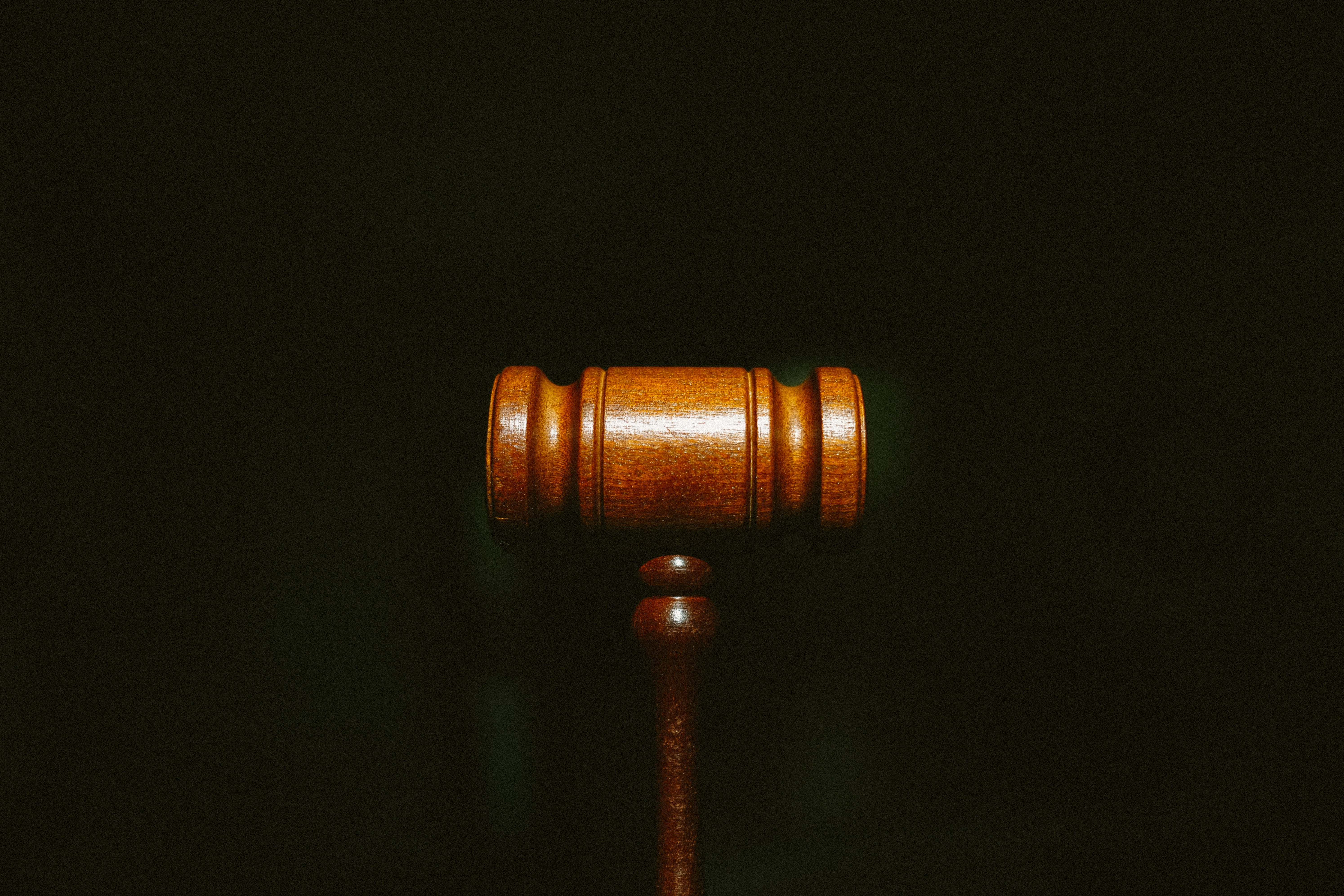 A gavel against a black background