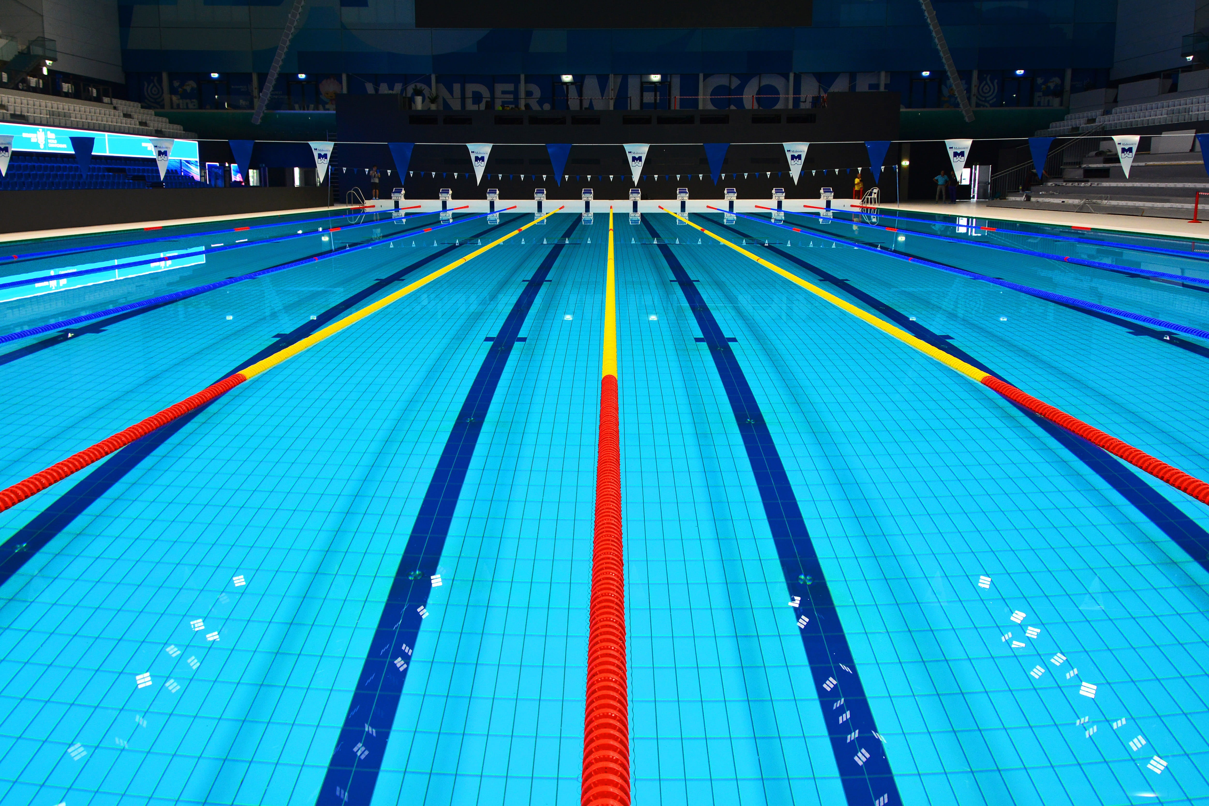A photograph showing the length of an indoor swimming pool