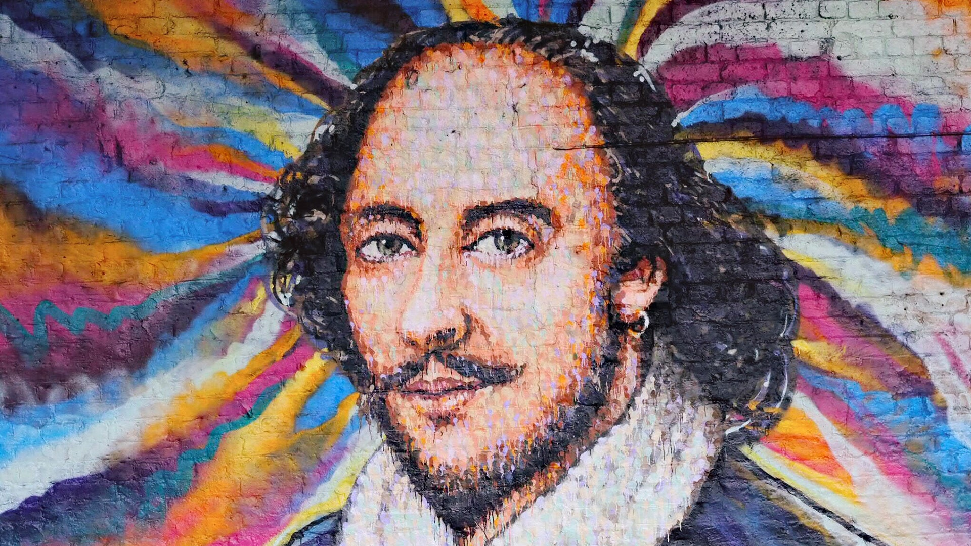 A colourful painted image of Shakespeare on a wall